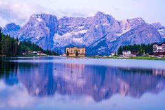 View of Punta Sorapis mountain of the Dolomites in the morning. With the reflection on the famous lake Misurina at Cortina d`Ampezzo in Italy stock image