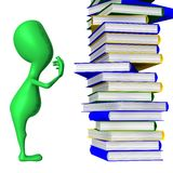 View puppy who looking on book column Stock Photo