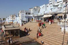 View of Pushkar Lake through buildings and people Stock Photos