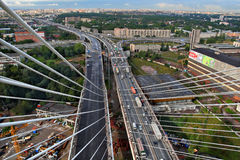 View from the pylon cable-stayed bridge at road interchange. Stock Photo