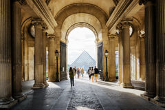 The view of the Pyramid of the Louvre through the Gate Sully in Stock Photo