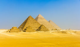 View of pyramids from the Giza Plateau: three Queens' Pyramids,. The Pyramid of Menkaure, the Pyramid of Khafre and the Great Pyramid of Giza (Khufu or Cheops Stock Photos