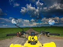 View from a quad bike in nature with amazing sky Royalty Free Stock Images