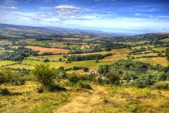View from Quantock Hills Somerset in colourful HDR towards Bristol Channel. View from Quantock Hills Somerset with bushes and trees in colourful HDR towards Royalty Free Stock Photography