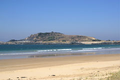 View of quarry hill and breakwater from beach in Australia Royalty Free Stock Photos