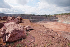 View into a quarry mine pit of phorphyry rock Stock Photo