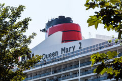 View of the Queen Mary 2 cruise ship in the port of Hamburg. HAMBURG, GERMANY - JUNE 6, 2016: View of the Queen Mary 2 cruise ship in the port of Hamburg on June Stock Photo