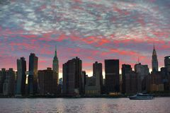 Sunset over Manhattan skyline. Royalty Free Stock Image