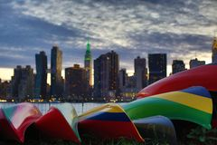 Sunset over Manhattan skyline with a boats. View from the Queens on sunset over Manhattan skyline. Hunters npoint location Stock Photos