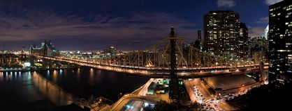 Queensboro Bridge in New York. A view of the Queensboro Bridge in New York by night royalty free stock photography