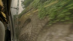 View from quickly moving train. Wall made of bricks. Outside the city limits. Tourists travel at high speed stock video
