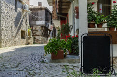 View of quiet street in old village. View of quiet street in old mediterranian village with place for your text Stock Image