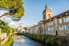 Les Récollets church in Saint Céré France at sunset. View of the Récollets church and Bave river in Saint Céré in summer Royalty Free Stock Photography