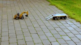 View of r/c model excavator and trailer on background. Free time children and adults concept