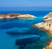 View of the Rabbits Beach or Conigli island, Lampedusa. View of the most famous sea place of Lampedusa, It is named Spiaggia dei conigli,  in English language royalty free stock photography