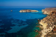 View of the Rabbits Beach or Conigli island, Lampedusa. View of the most famous sea place of Lampedusa, It is named Spiaggia dei conigli,  in English language royalty free stock image