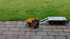 View of radio controlled model  dump truck and trailer free time. Children and adults concept. Hobby.