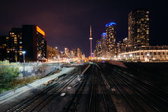 View of a rail yard and modern buildings in downtown at night, f Royalty Free Stock Images