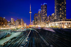View of a rail yard and modern buildings in downtown at night, f. Rom the Bathurst Street Bridge in Toronto, Ontario Royalty Free Stock Image