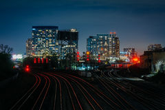 View of a rail yard and modern buildings at night, from the Bath. Urst Street Bridge in Toronto, Ontario Royalty Free Stock Image