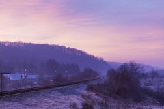 Diesel train rail in a bend. View in morning and a forest in background royalty free stock image