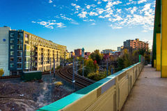 View of railroad tracks and buildings from a bridge in Baltimore Royalty Free Stock Photos