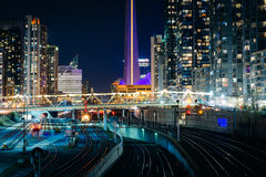 View of railroad tracks and modern buildings in downtown at nigh Royalty Free Stock Images