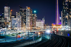View of railroad tracks and modern buildings in downtown at nigh Royalty Free Stock Photo