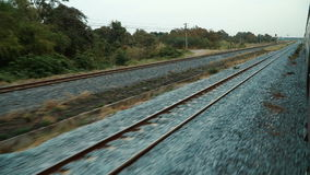View of railroad tracks from the train window. stock footage