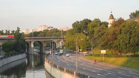 View of the railway bridge over the Yauza river and roadway of its embankment in sunset light, Moscow. stock video