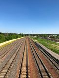 View of the railway going away and the blue sky.  stock photography