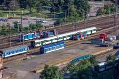 View of railway station with trains. Top view of trains and locomotives on train station stock image