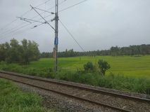 View of a railway track in Kerala, India. View of a railway train track in Chandera, Maniyat, Kerala, India Stock Photo