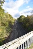 View of the railway track seen from an old bridge - photo taken in Leamington Spa, UK. Railway track seen from the height of an old bridge in Leamington Spa UK royalty free stock images