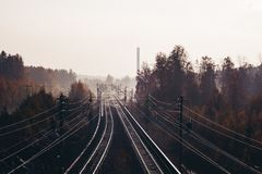 View of railway tracks in the morning with mist, Vantaa Finland. View of railway tracks and trees in the morning with mist, Vantaa Finland royalty free stock photo