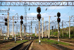 View on railway with traffic lights. Railway traffic lights show a stop signal Stock Photos