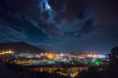 View on railways systes in city Tuapse from above. Night view with railways and oil plant during full moon stock video