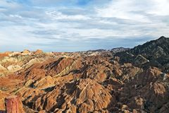 View of Rainbow Mountains Geological Park. Stripy Zhangye Danxia Landform. Geological Park in Gansu Province, China. Valley on a Sunny Day royalty free stock photography