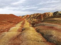 View of Rainbow Mountains Geological Park. Stripy Zhangye Danxia Landform. Geological Park in Gansu Province, China. Valley on a Sunny Day stock image