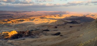 Trekking in Negev dramatic stone desert, Israel. View of ramon crater desert of southern israel during hiking Stock Image