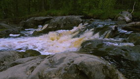 View on rapids of raging river stock footage