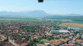View from Rasnov Citadel, Romania, zooming from wooden balcony