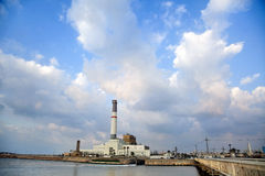 Power Plant by the River. View at 'Reading' power plant located by the mouth HaYarkon river (where it connects with the Mediterranean sea) in Tel-Aviv, Israel Royalty Free Stock Photo