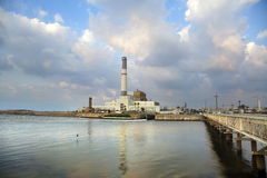 Power Plant by the River. View at 'Reading' power plant located by the mouth HaYarkon river (where it connects with the Mediterranean sea) in Tel-Aviv, Israel Royalty Free Stock Image