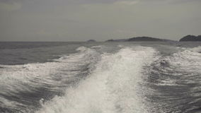 View from the rear of moving speedboat stock footage