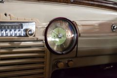 View from rear seat on the steering wheel and the interior of the old Russian car of the executive class released in the Soviet royalty free stock photo