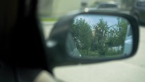 View in the rear view mirror in the car stock video footage