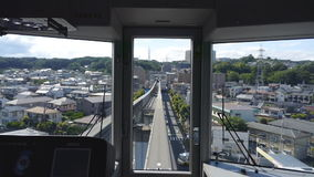View from the rear window of a monorail stock footage