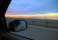 View in the rearview mirror on the car. On highway royalty free stock photos