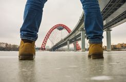 View of the red arch of the picturesque bridge between the legs. The bridge between the legs, noli on the ice stock images